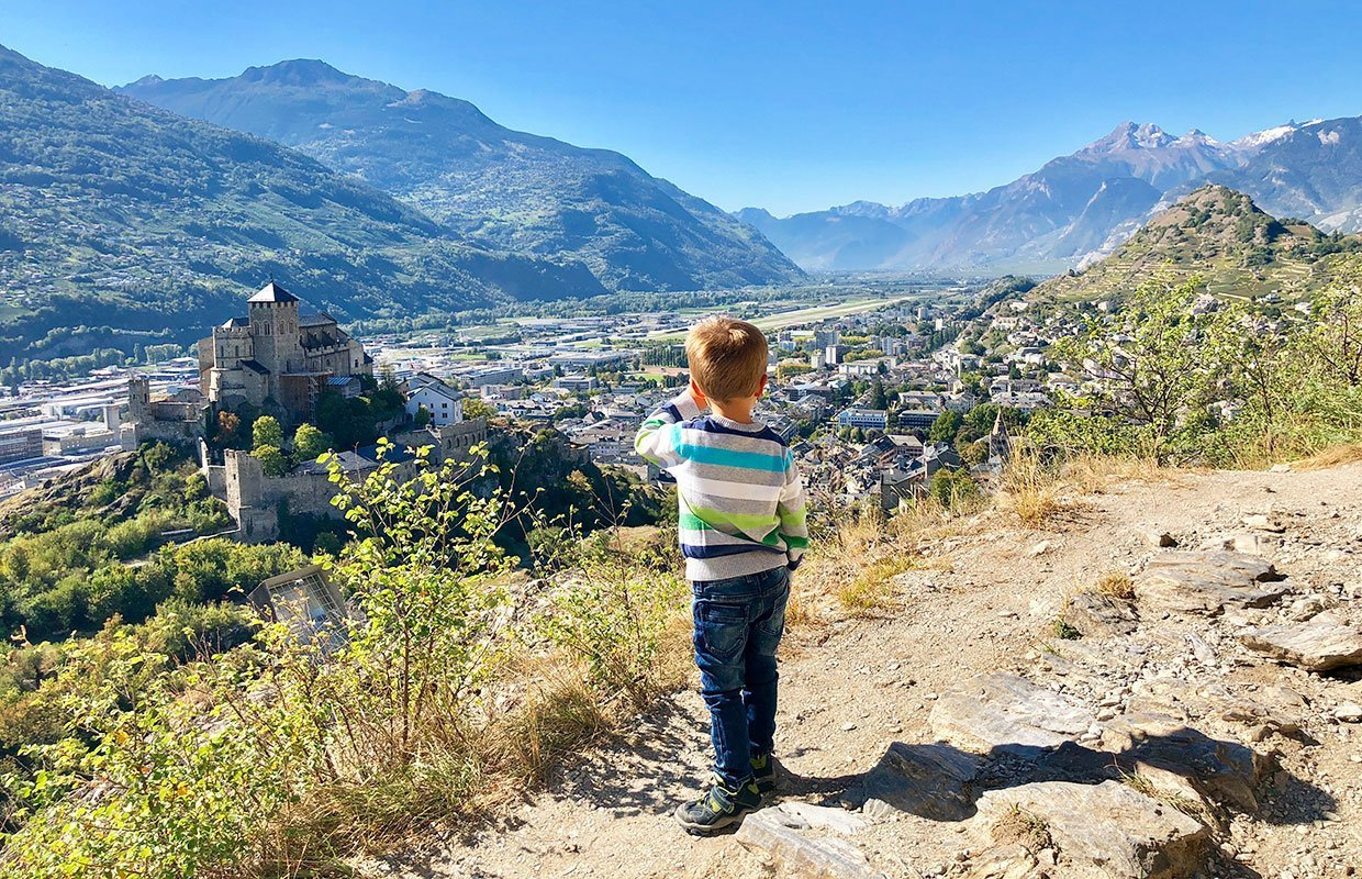 boy looking down on castle