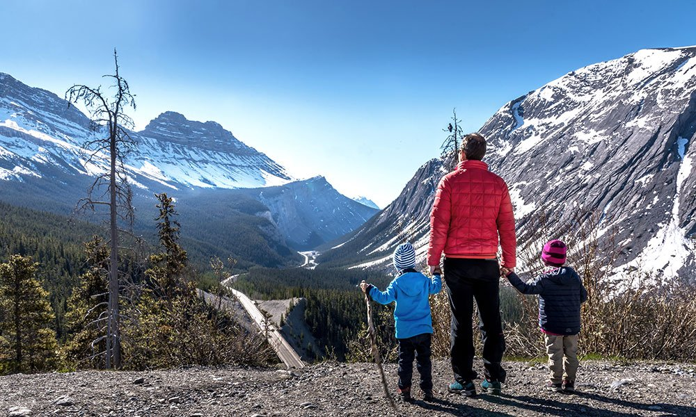 family standing at Mount Cirrus lookout in the Icefields Parkway