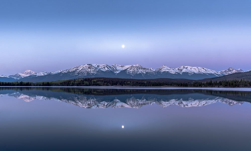 Sunrise at Pyramid Lake with the moon shining on the water