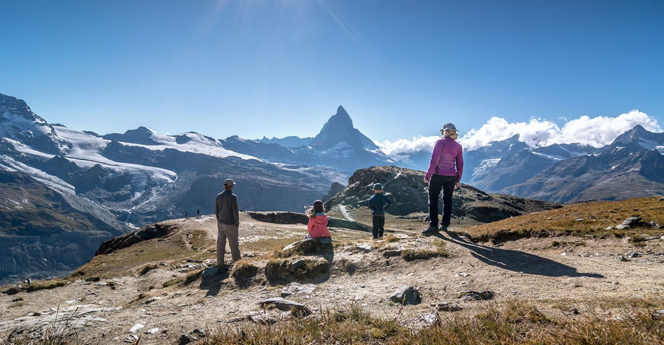 family standing at Riffelberg with view to the Matterhorn