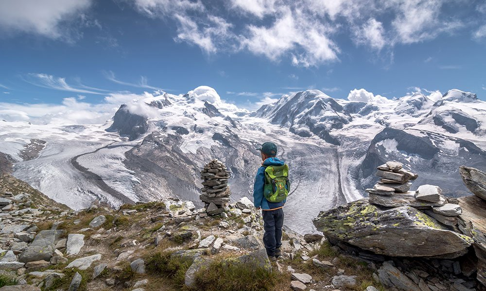 boy watching over the gorner glacier at the Gornergrat