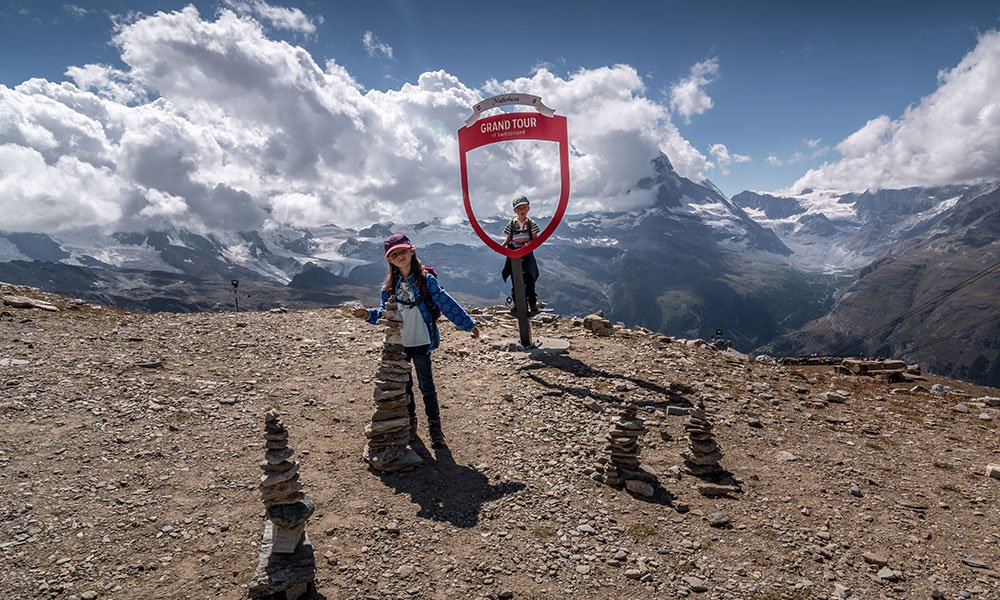 kids at the grand swiss tour photo spots at Rothorn in zermatt