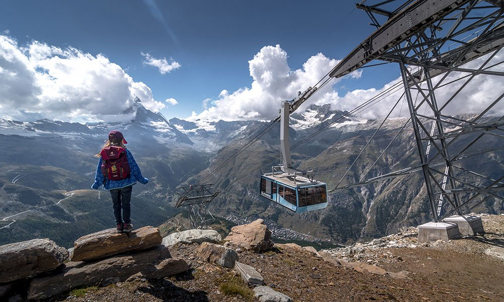 girl standing at the Rothorn station in Zermatt