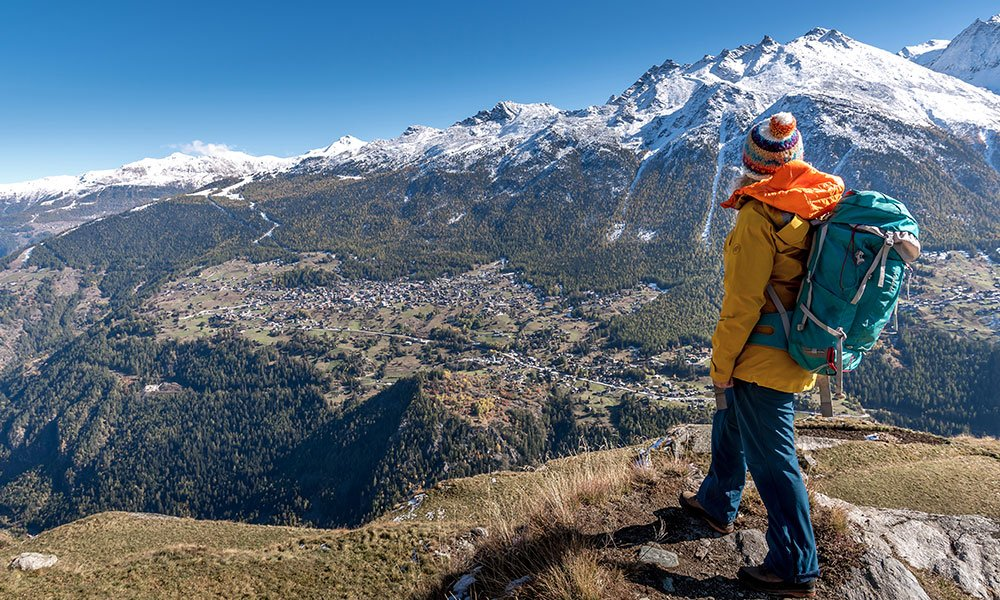 woman standing at Jungen Alp looks at Grächen in Valais