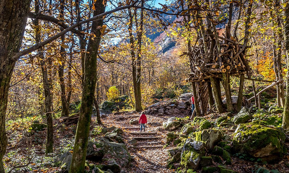 girl walking the bobosco trail in Ticino Verzasca
