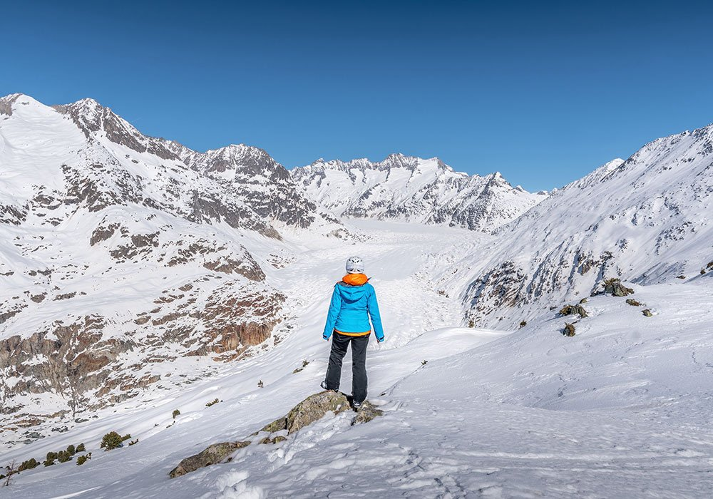 woman standing at view point to Aletsch Glacier