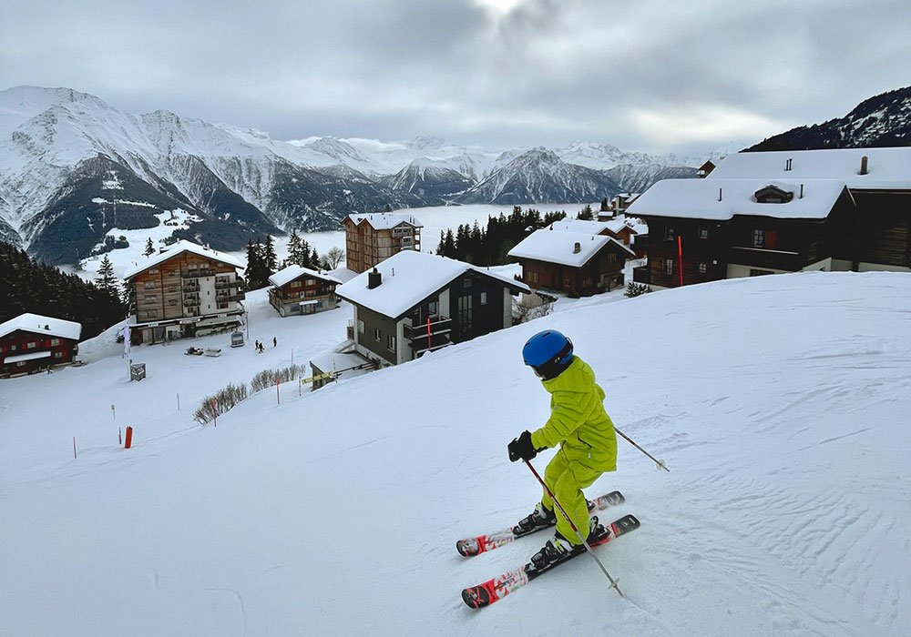 Boy skiing close to accommodation in Bettmeralp