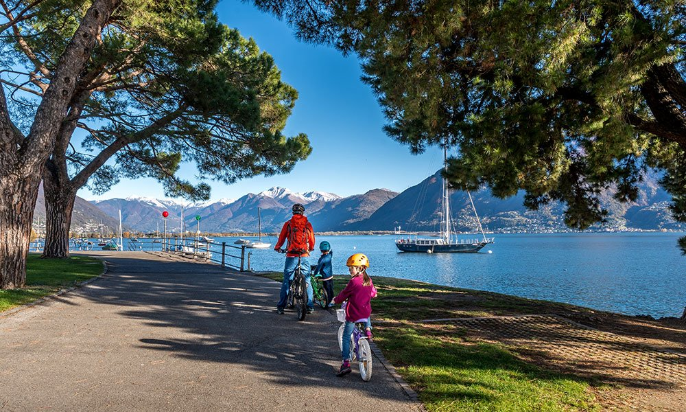 Family biking along the best places to visit in Ticino lake shore
