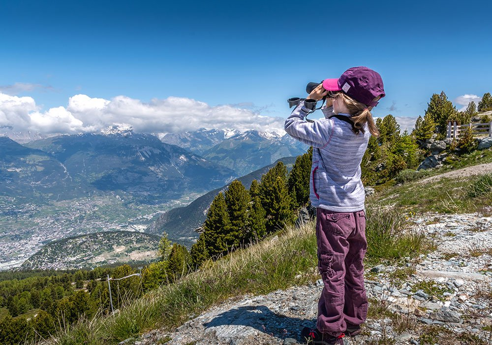 Girl marvelling at the view at cretics du midi in Vercorin