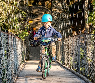 little boy cycling over Pont Turrian.