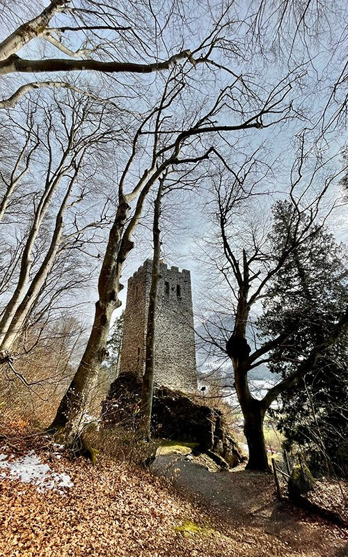 A stone tower in the forest in Meiringen Haslital. the Restiturm