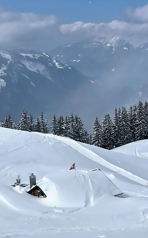 snow-covered Swiss mountain chalet at Hasliberg